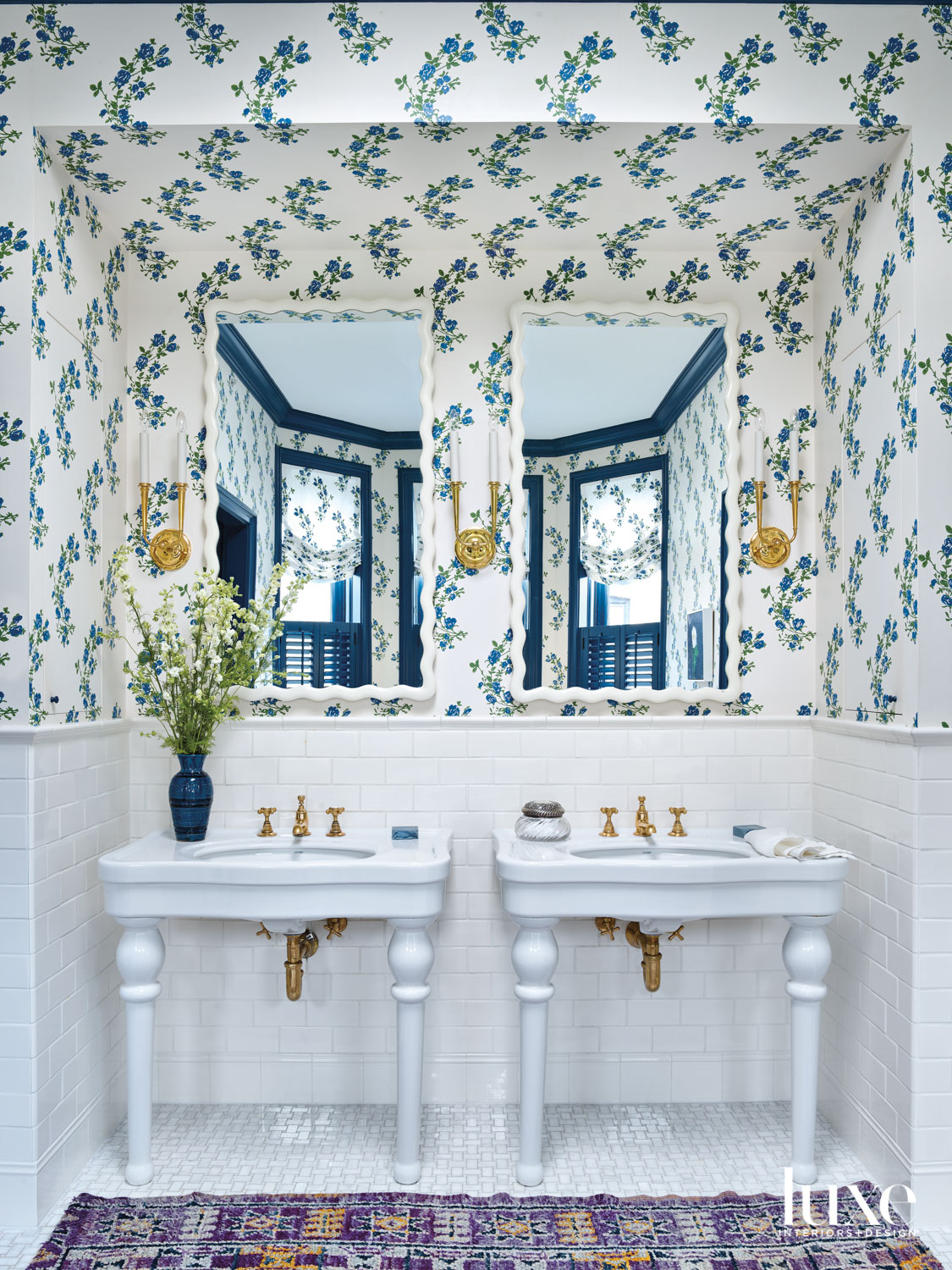 A bathroom with blue-and-white floral...