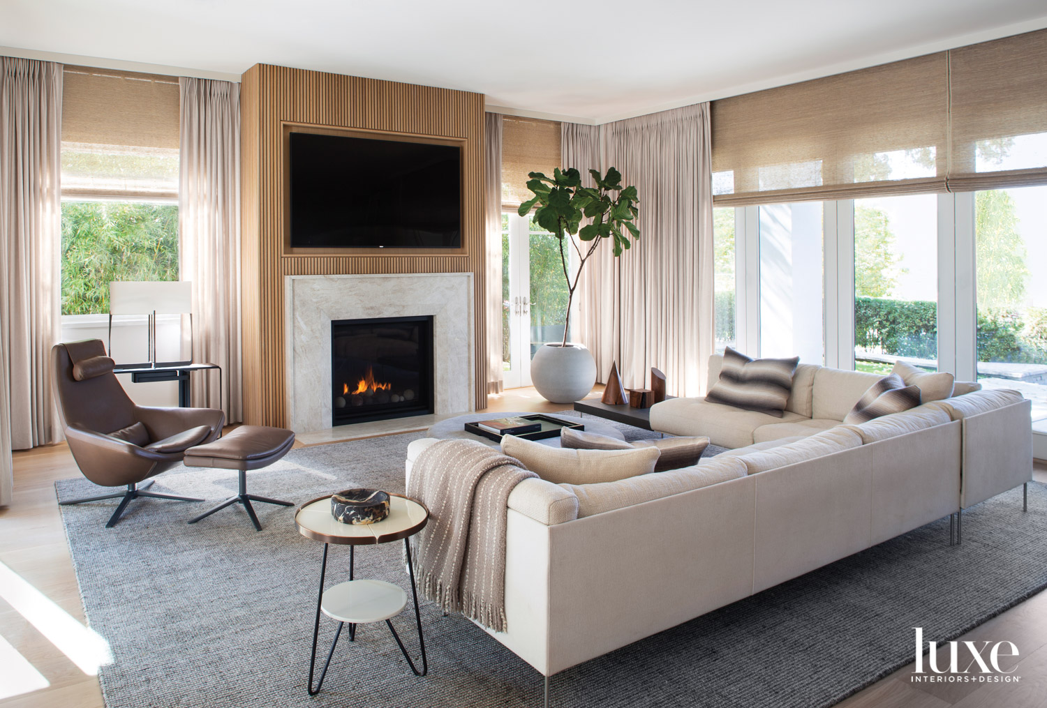 A family room features a...