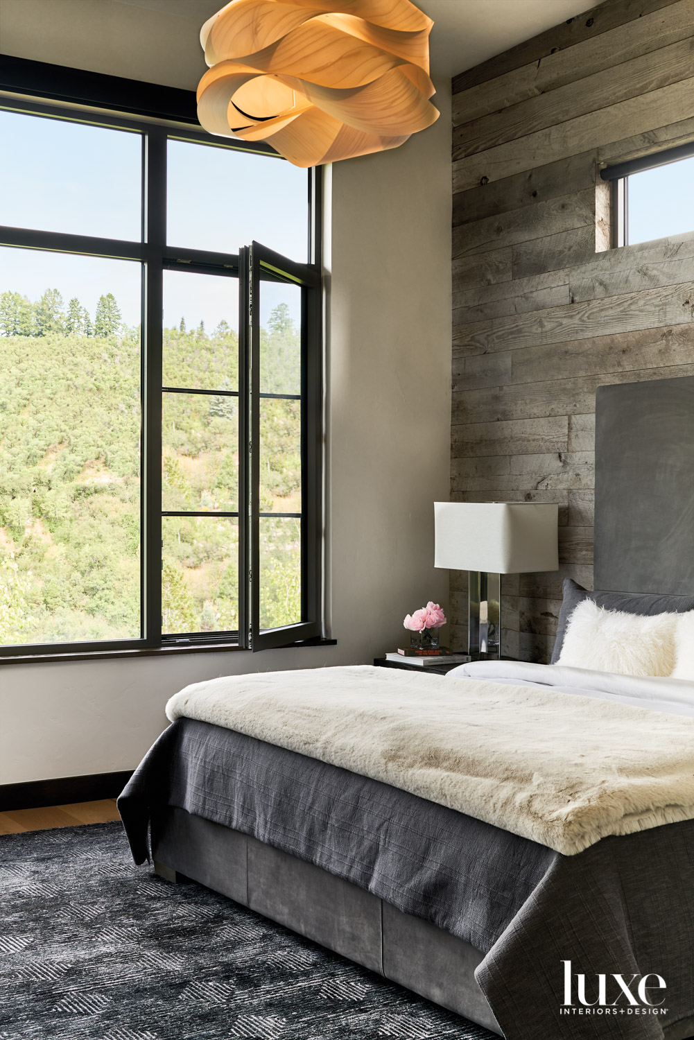 rustic bedroom with views of...