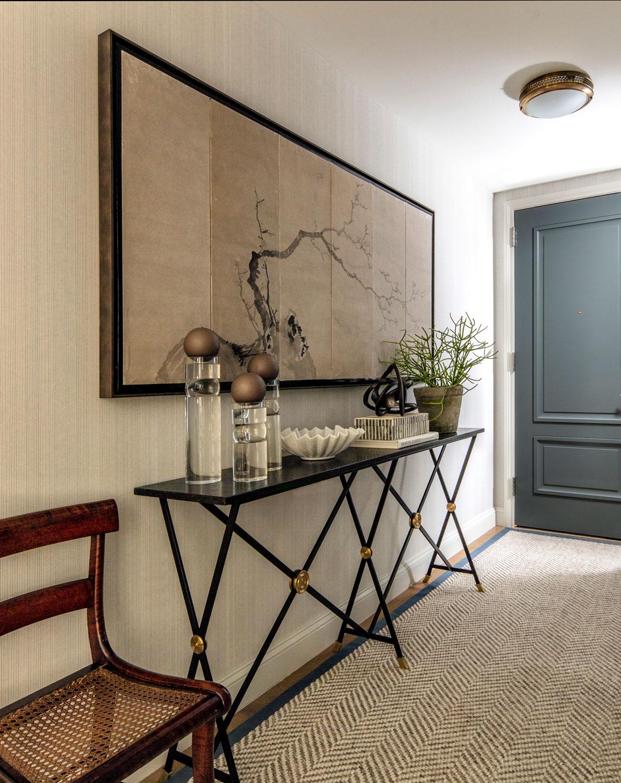 neutral foyer with herringbone rug...