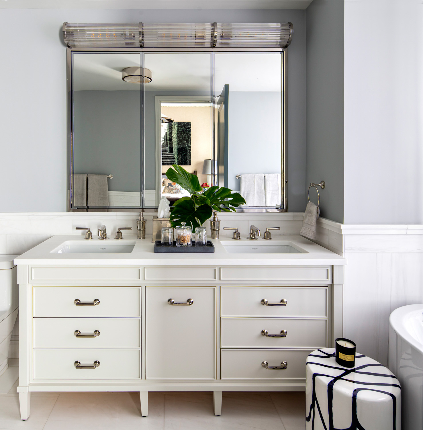bathroom with traditional vanity and...
