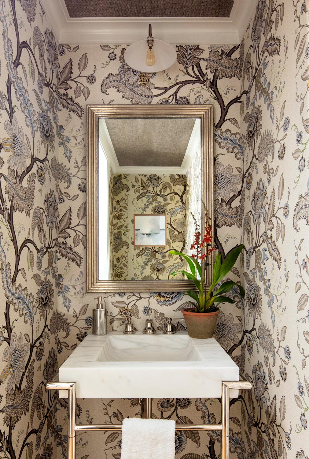 powder room with tonal floral...