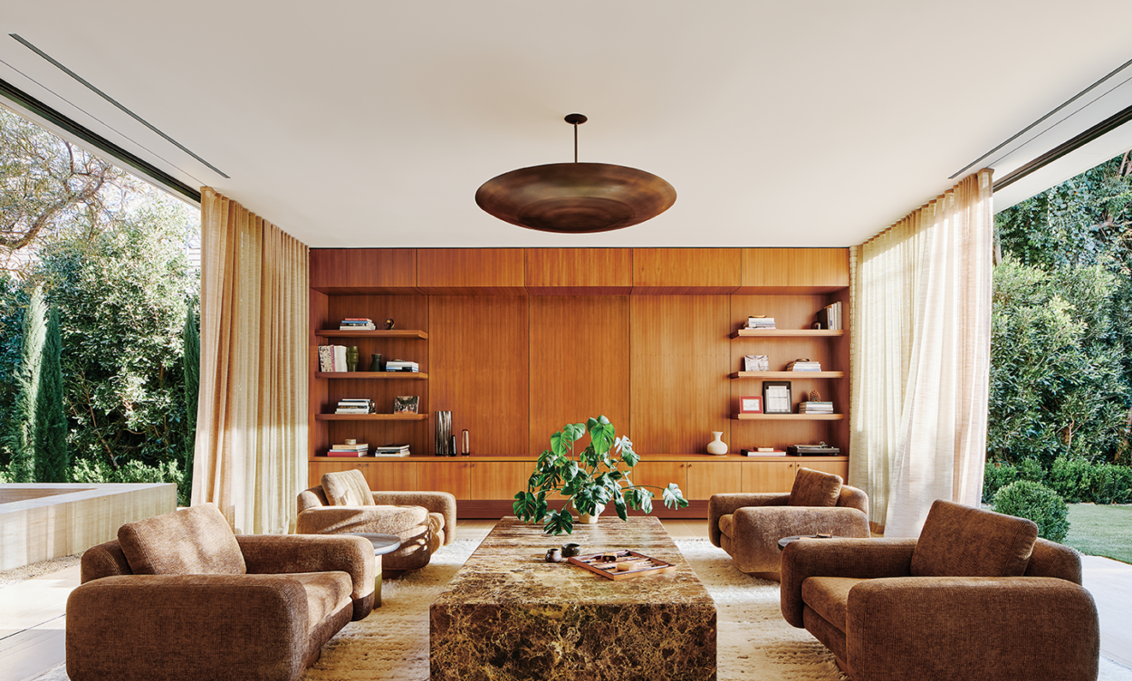 brown modern living room with paneling and marbled stone