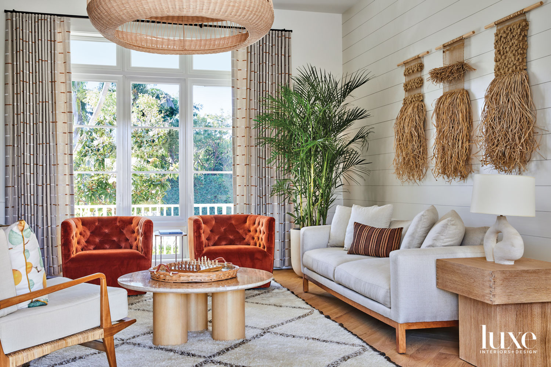 living area with burn-orange armchairs,...