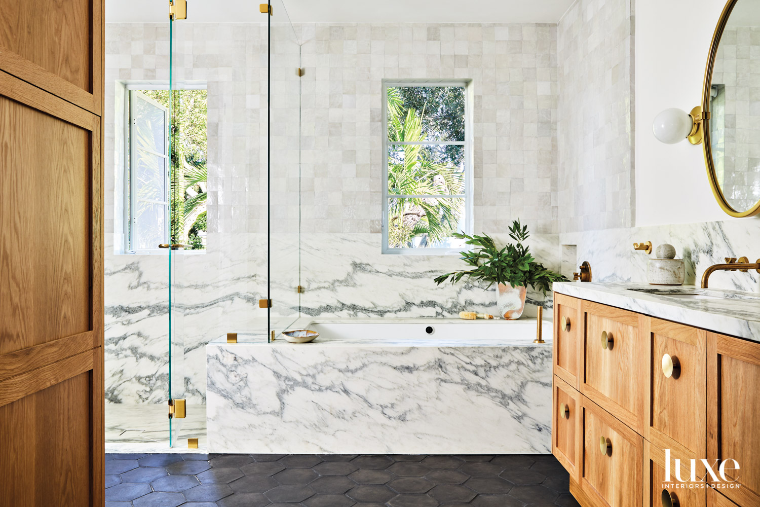 bathroom with marble tub and...