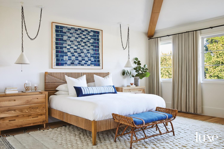 bedroom with white walls, raffia...