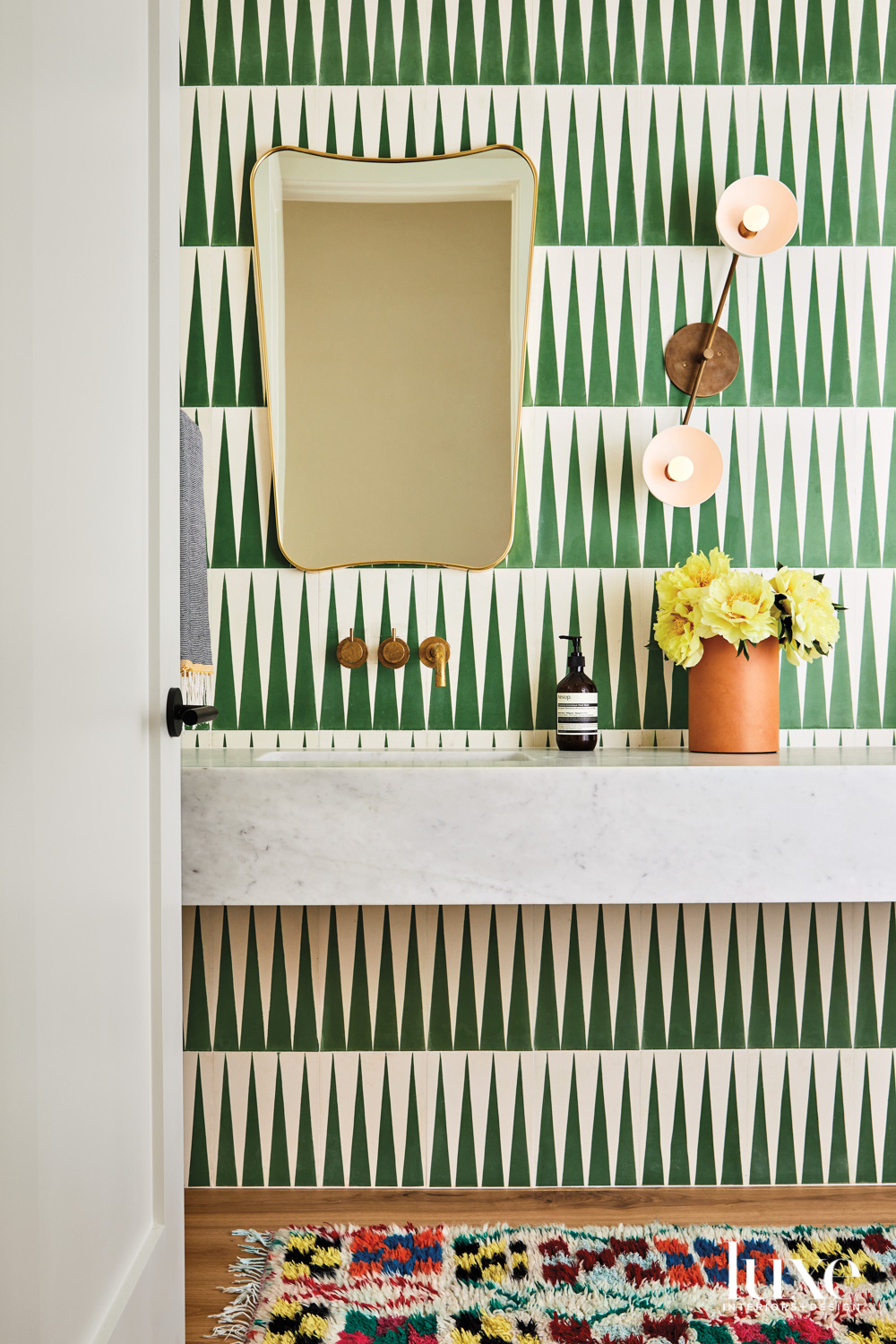 powder room with green and...
