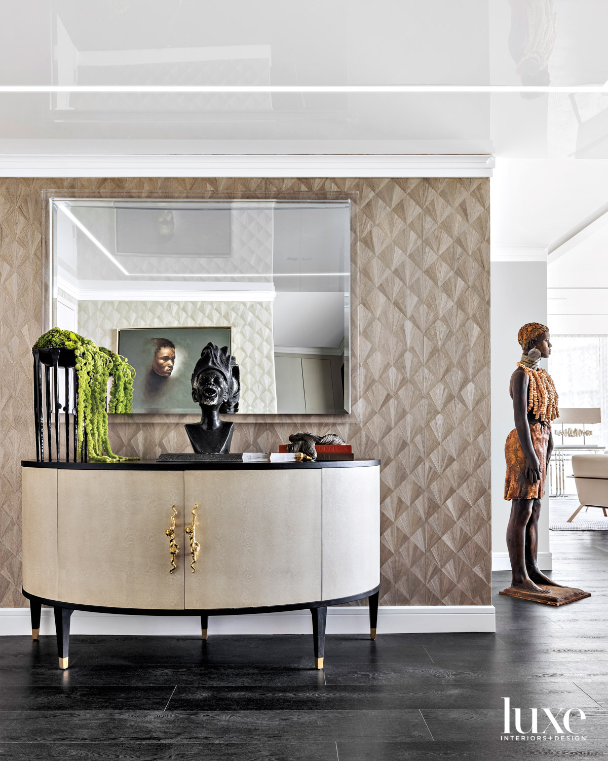 foyer with statement wall, sideboard...