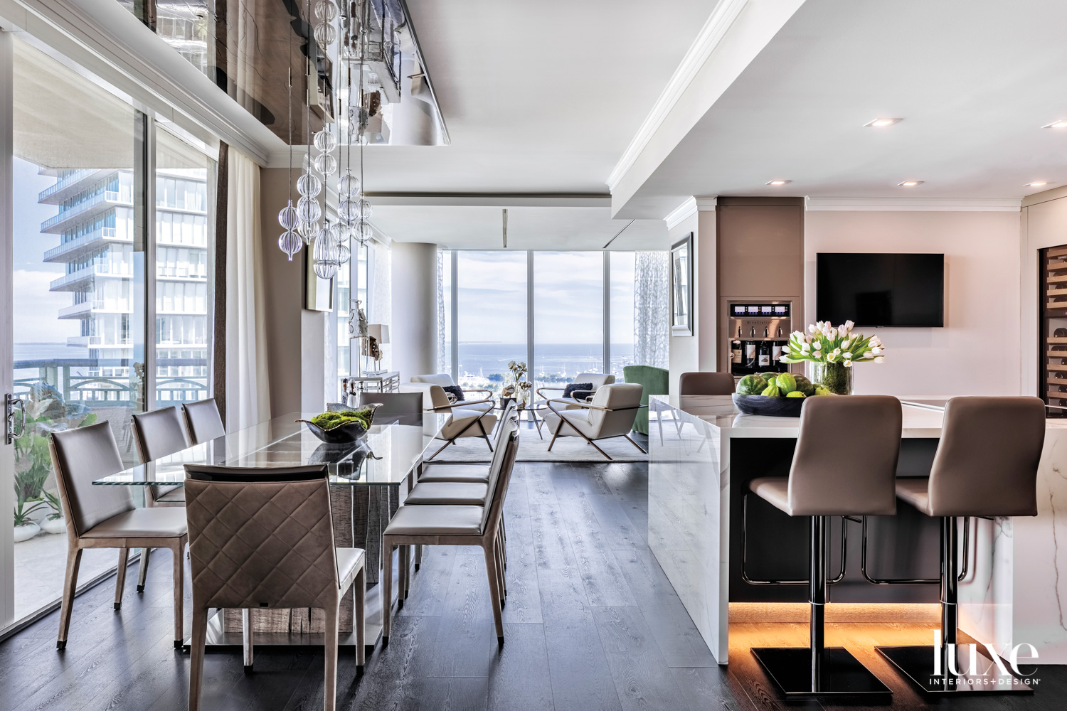 dining area with gray chairs,...