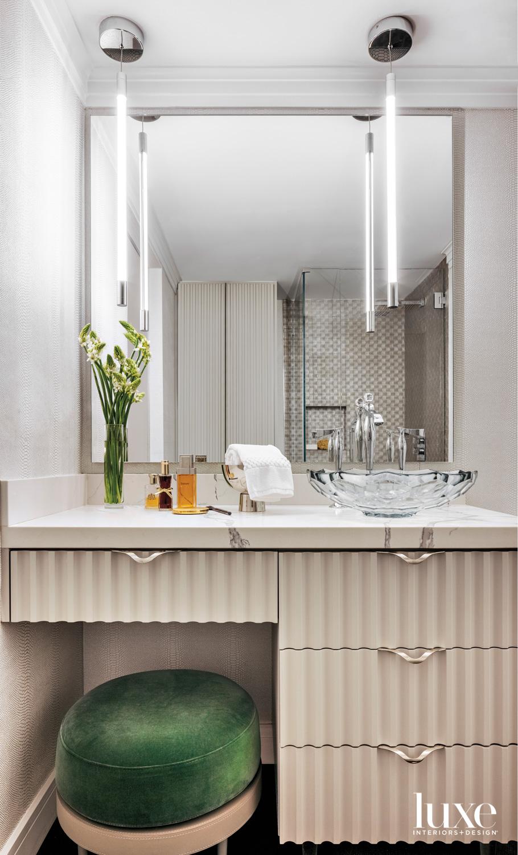 bathroom vanity with green stool,...