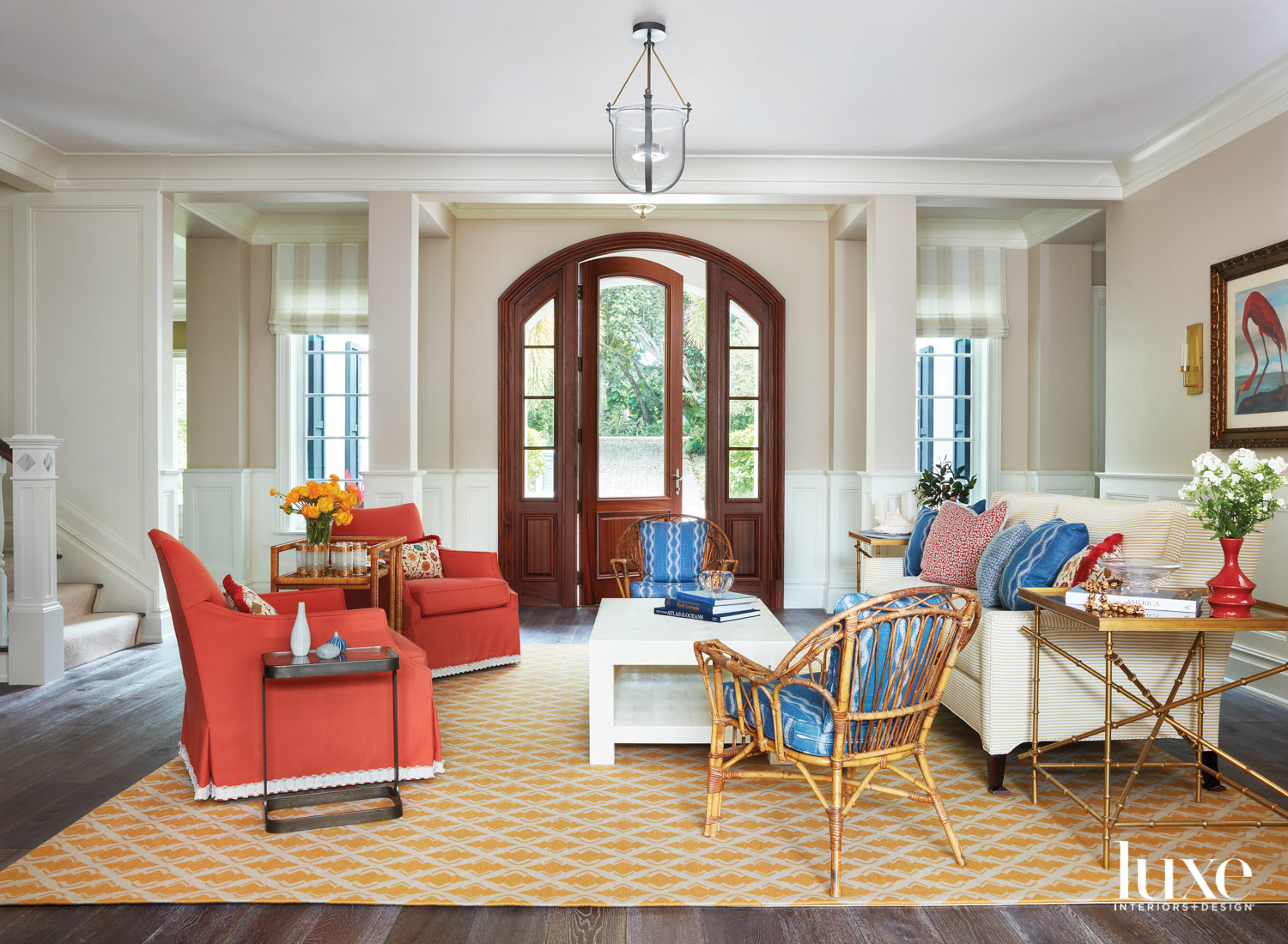living area with coral armchairs,...