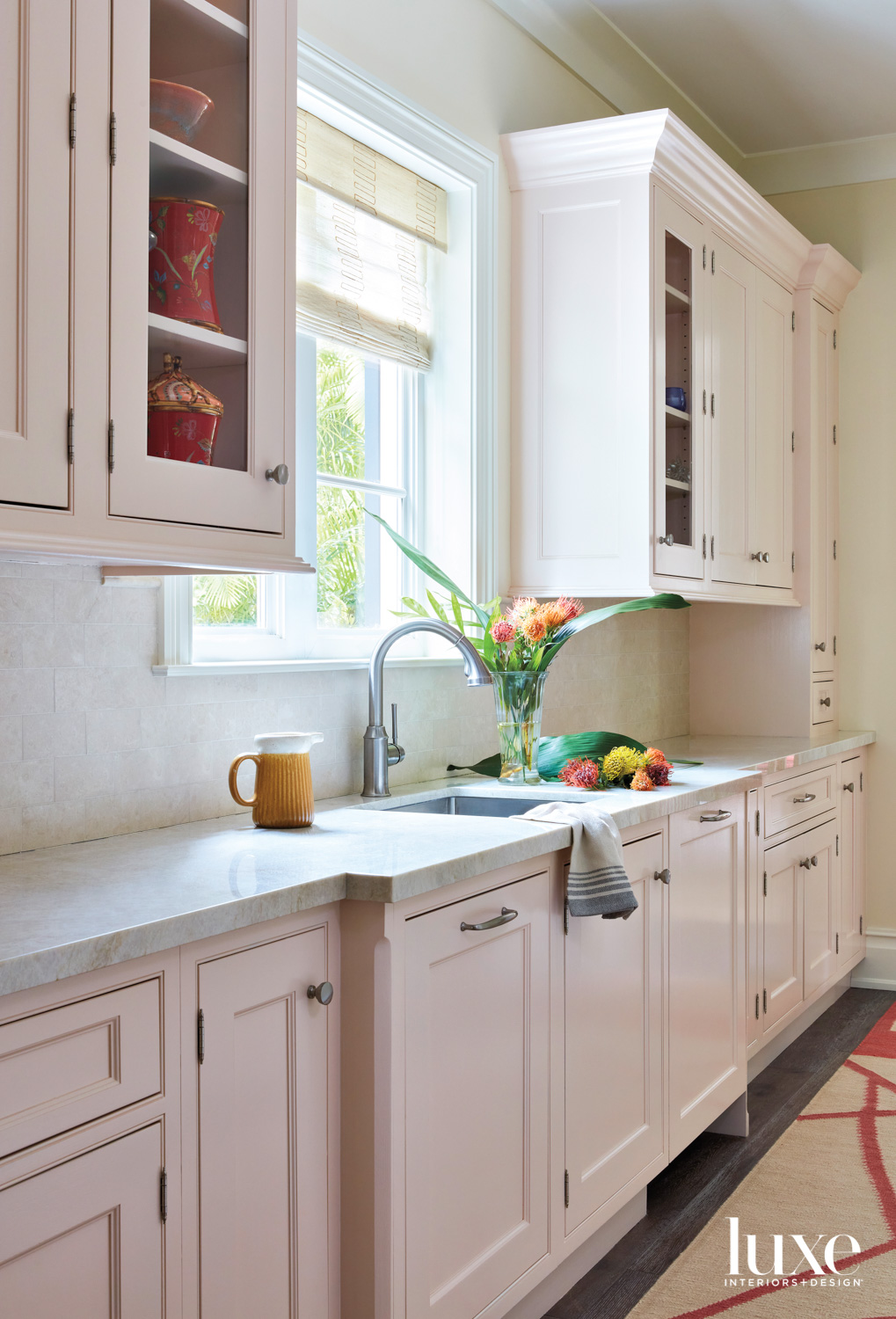 pantry with light pink cabinetry,...
