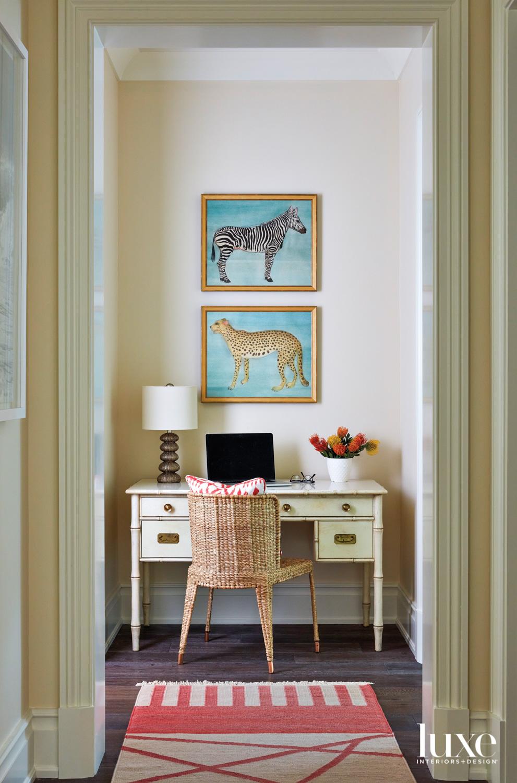 desk nook with animal artworks,...