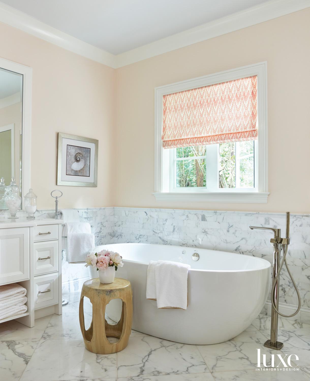bathroom with carrara tile flooring...