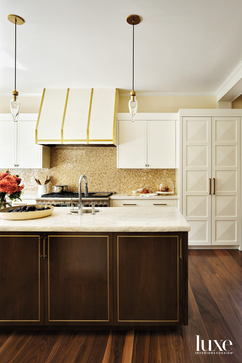 The kitchen has brass accents.