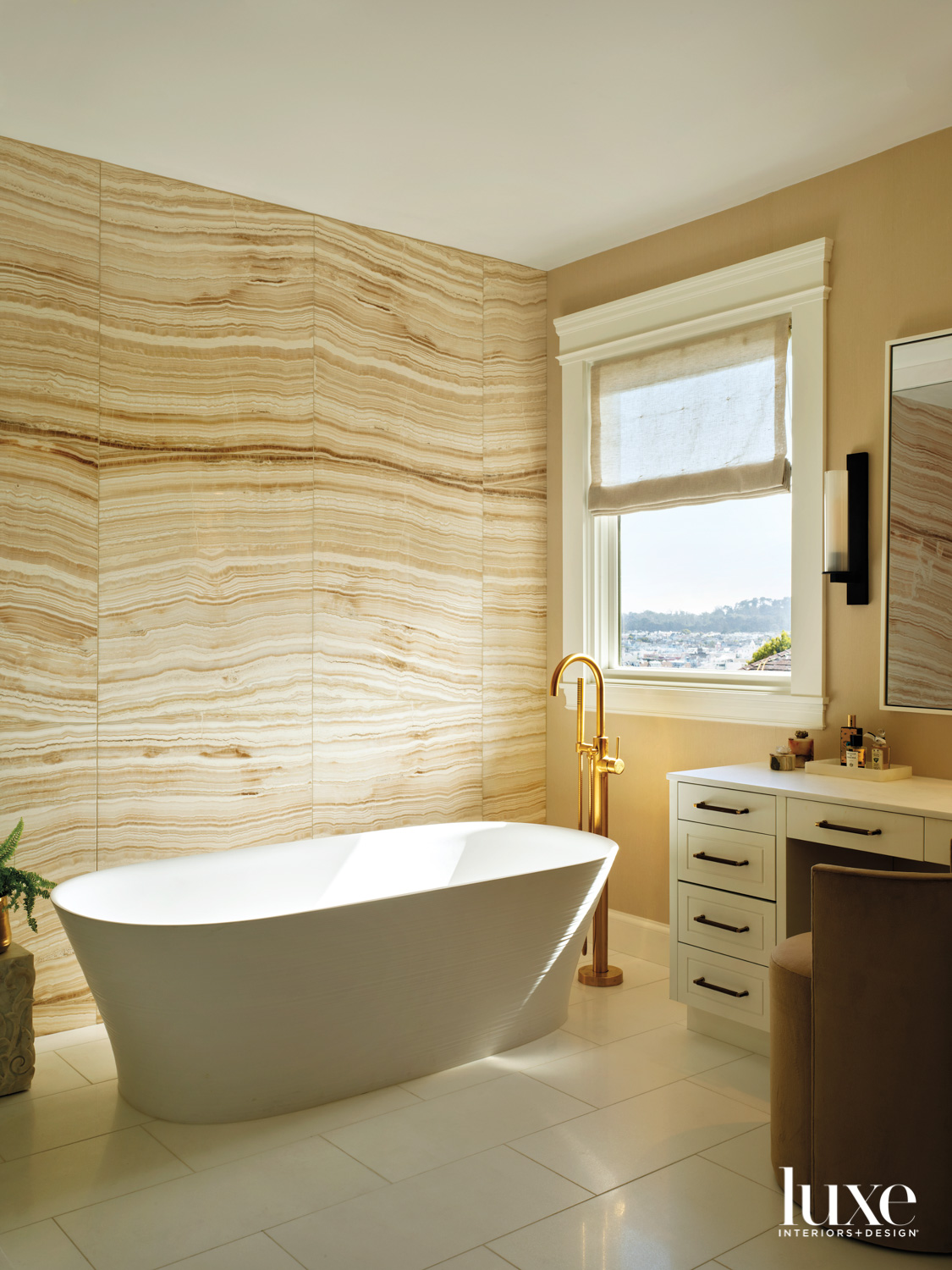 A primary bathroom features stone walls with a strong pattern.