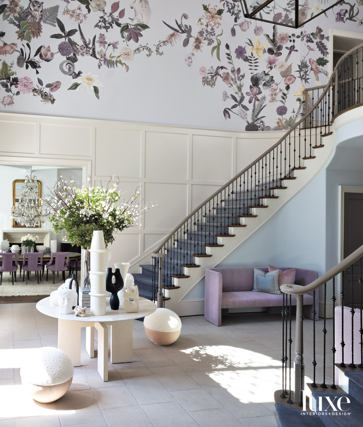 Large, double-height foyer with pale...