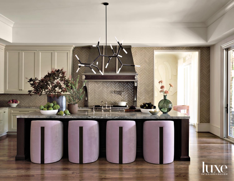 Warm-toned kitchen with dark vent...