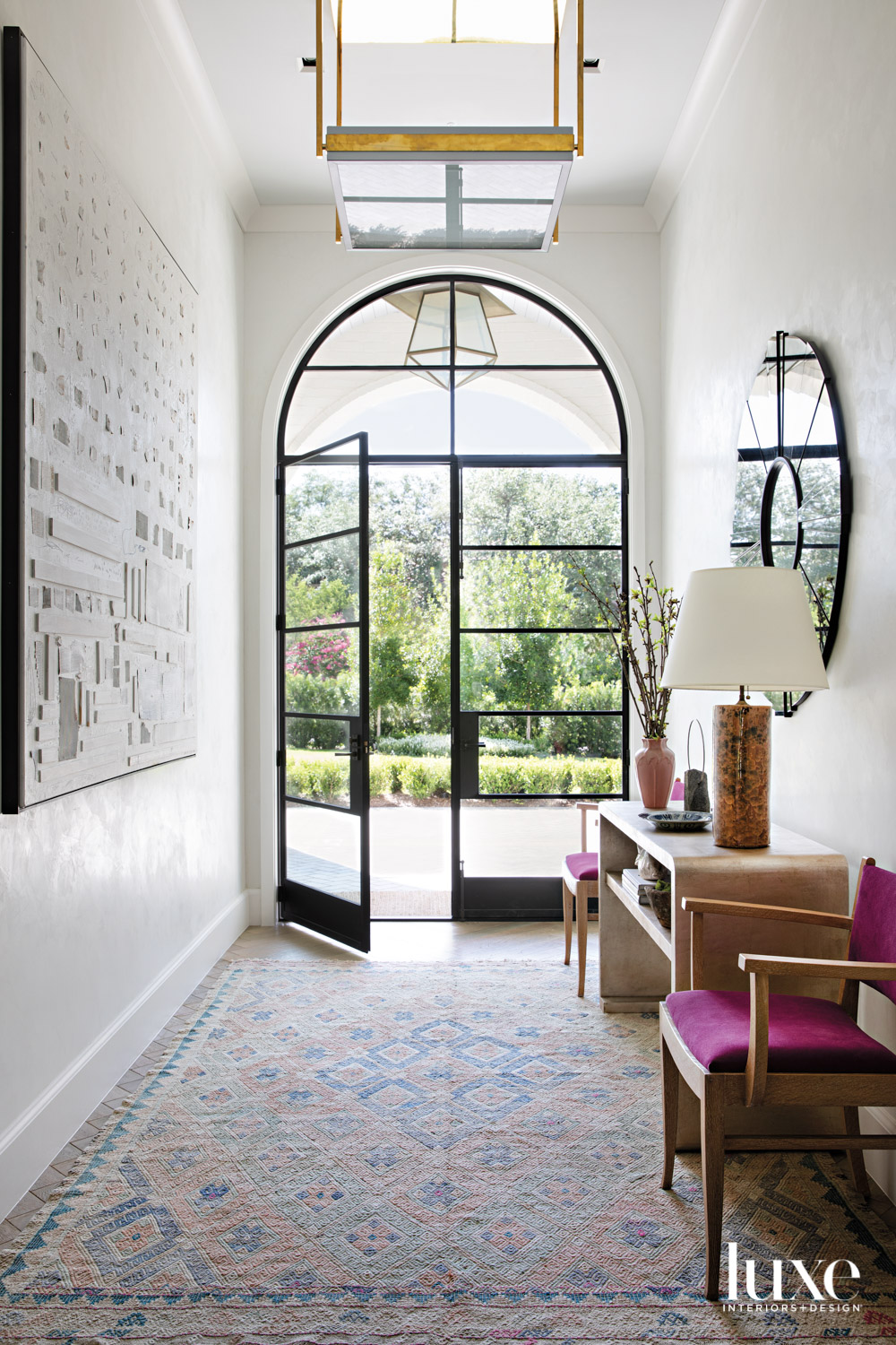 large light-filled entry with a...