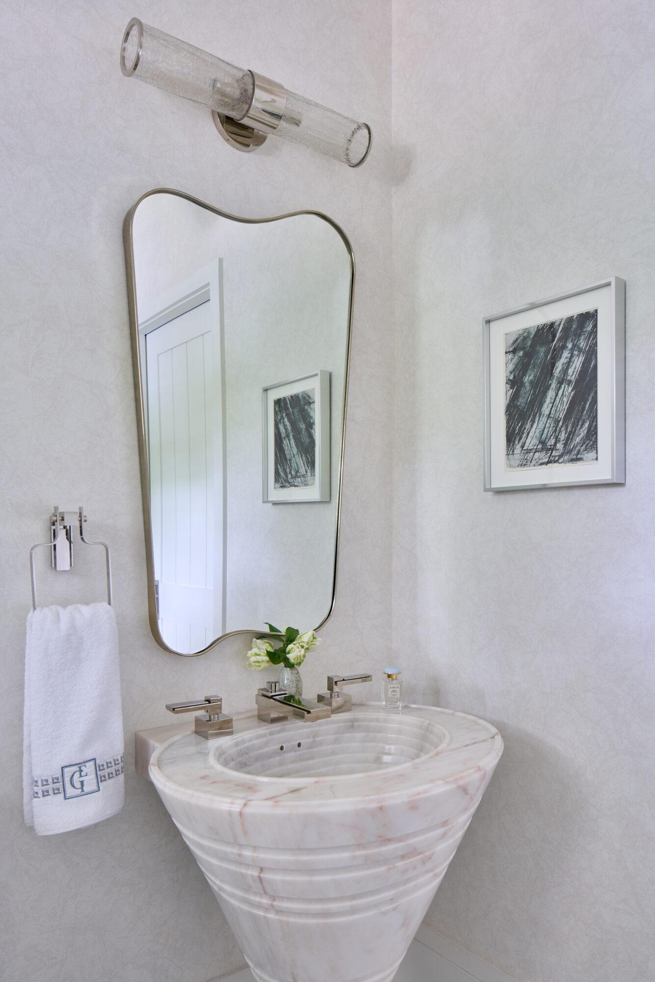 organic shaped curved bathroom mirror and stone sink Elizabeth gill interiors