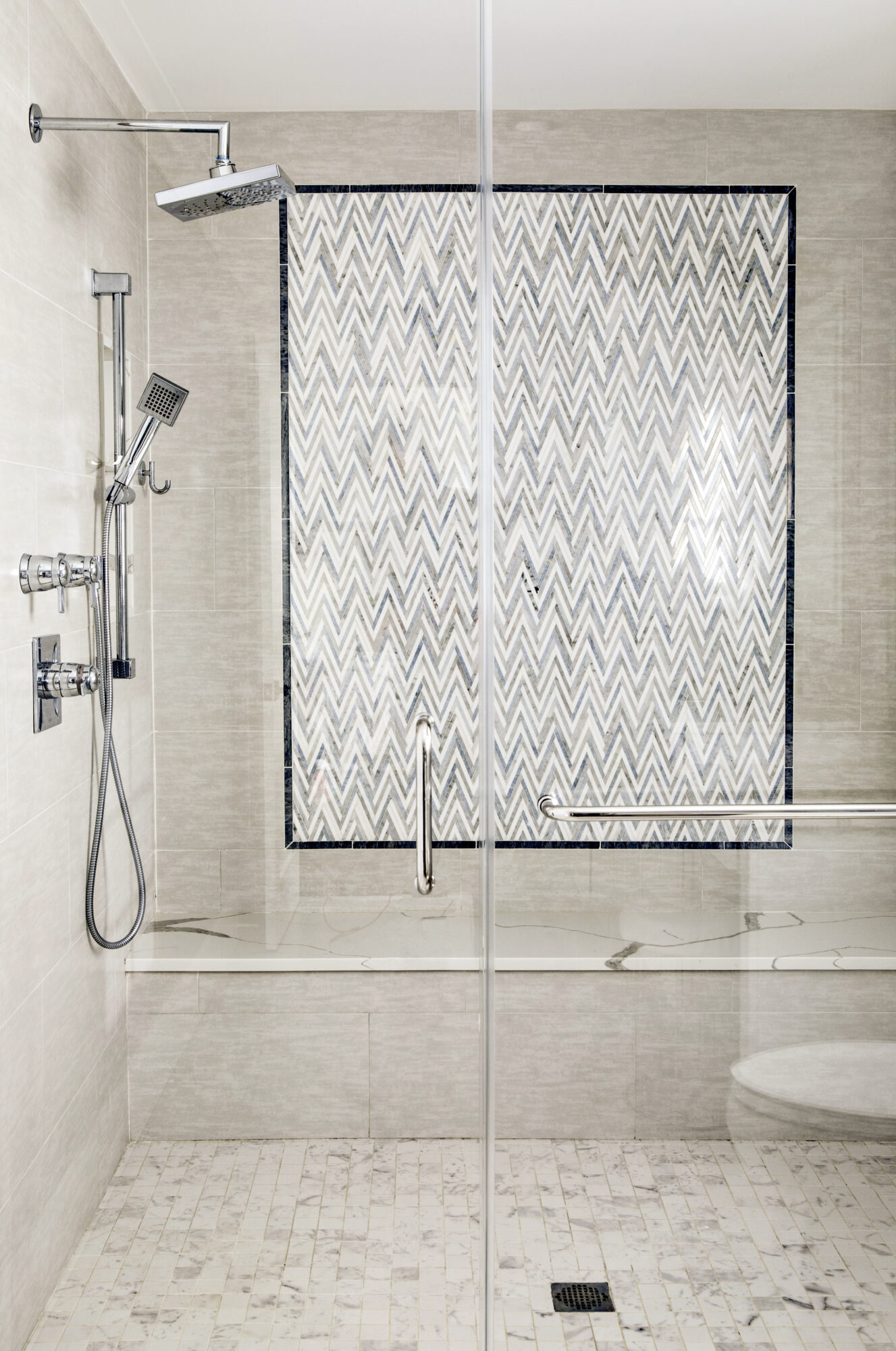 shower feature wall with chevron tile pattern
