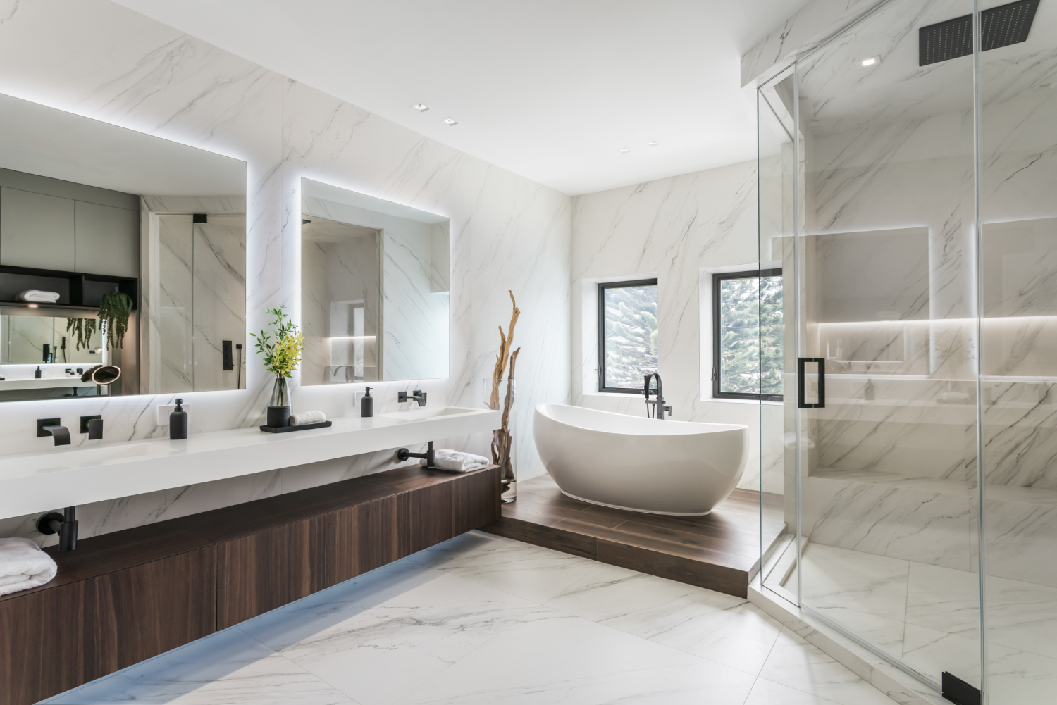 Large bathroom with soaking tub, shower stool and dark wood double vanity