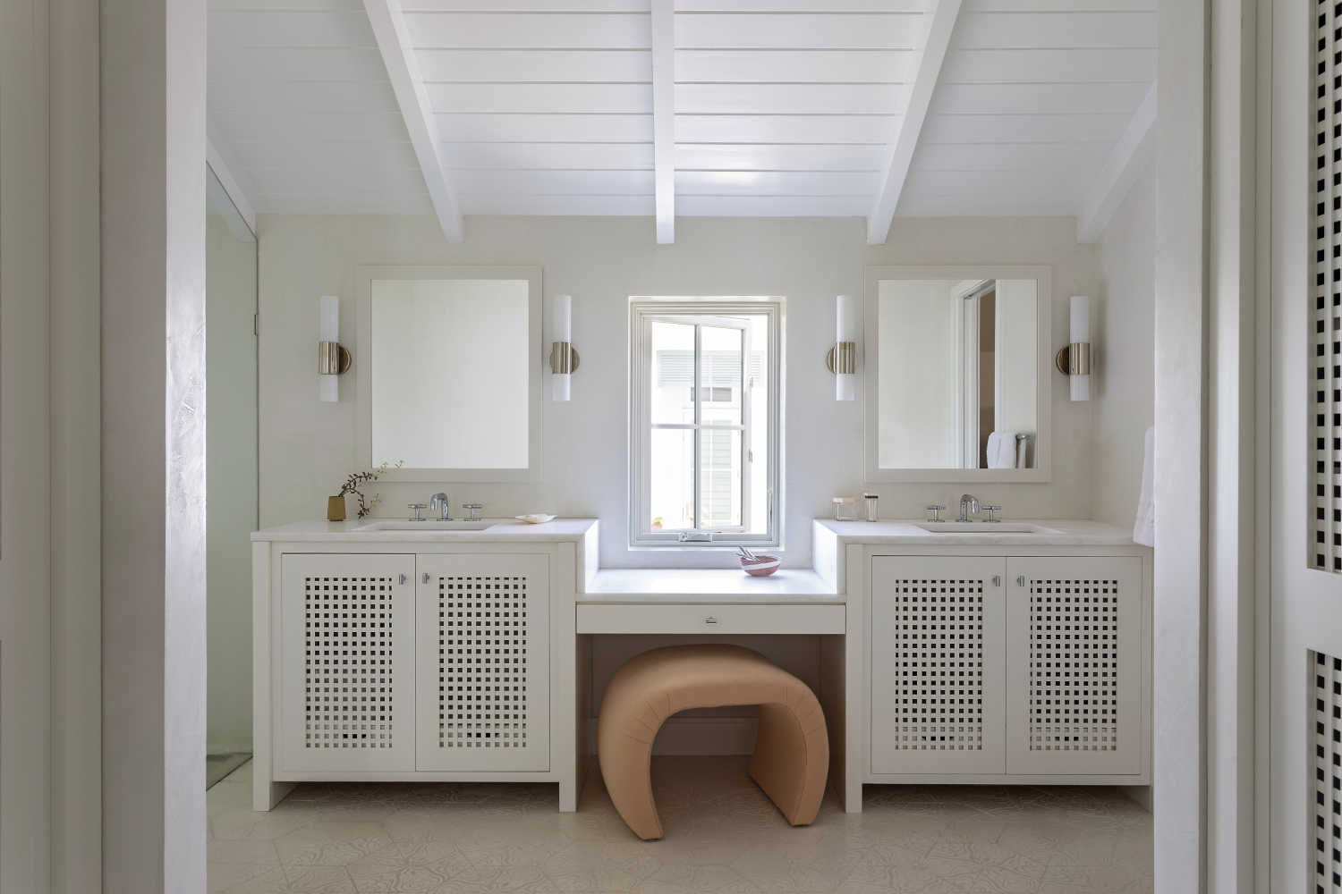 White bathroom with window and two vanity sinks