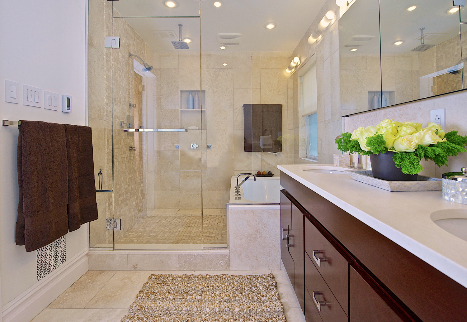 Neutral bathroom with tub inside a glass shower stall