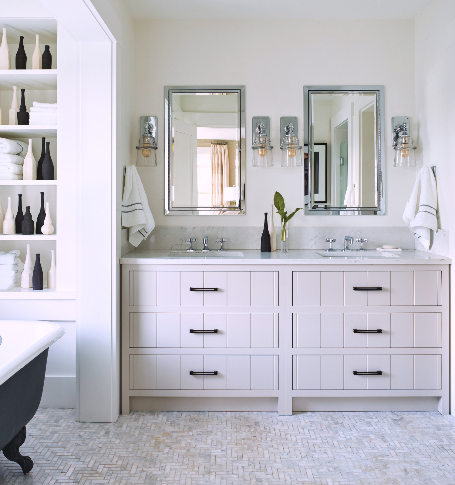 White bathroom with double vanity and open shelving