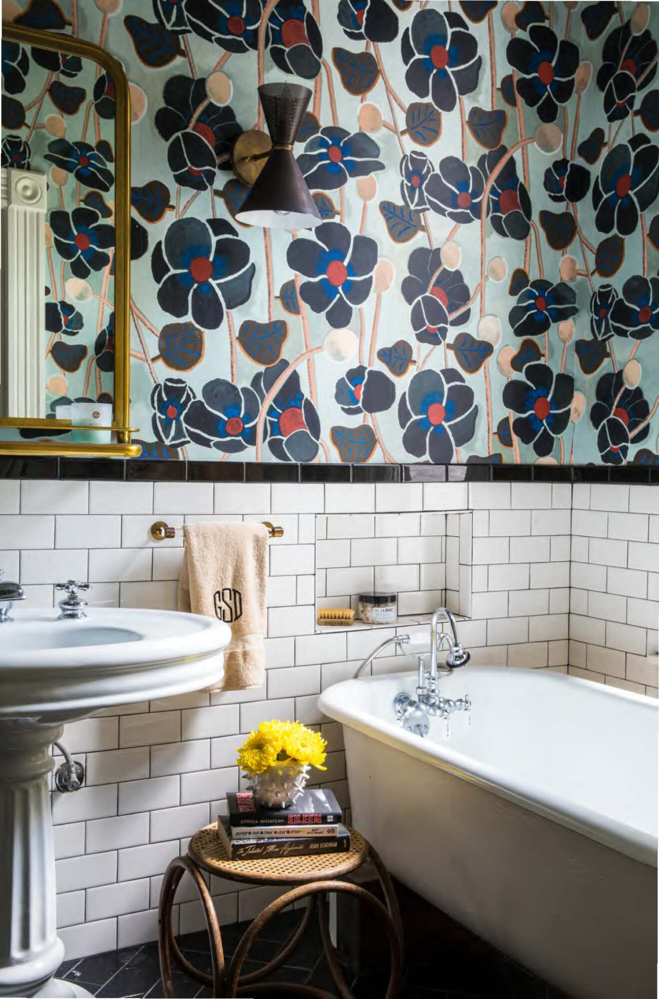 Bathroom with white tile and floral wallpaper