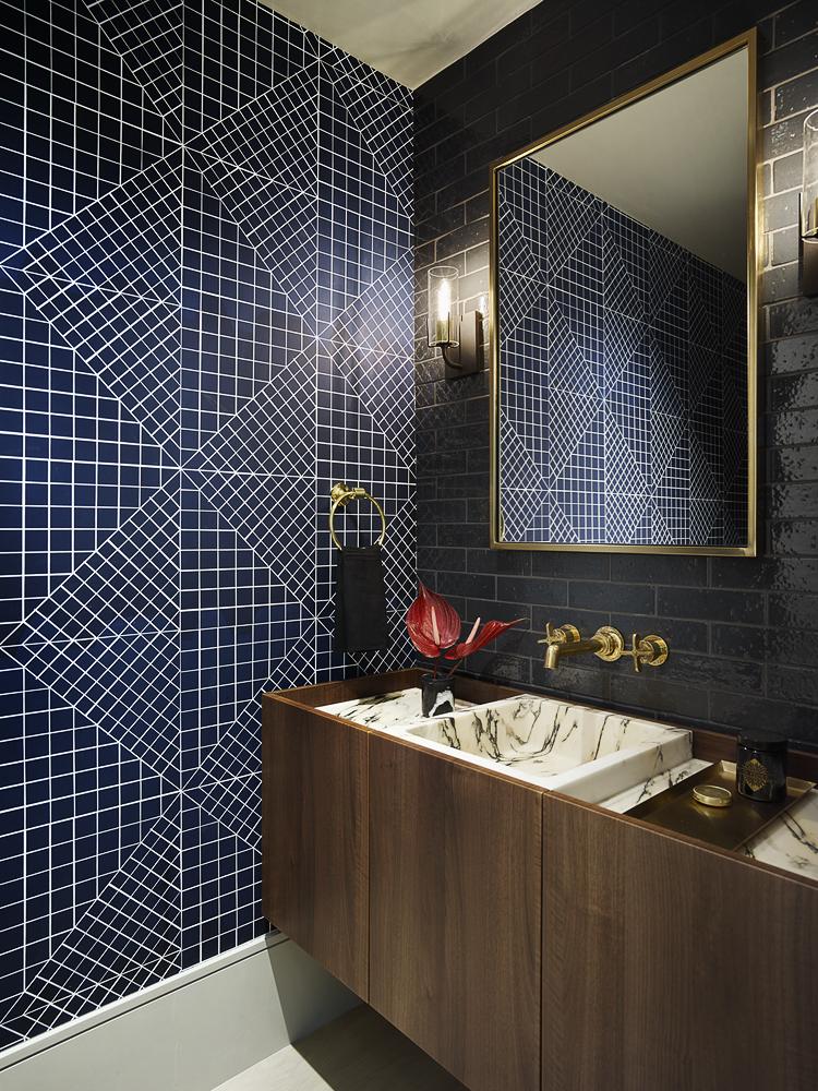 blue tile bathroom with blue wallpaper